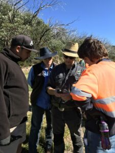 Staff members from Gunaikurnai Land and Waters Aboriginal Corporation (GLaWAC), East Gippsland Catchment Management Authority (EGCMA) and Taungurung Clans Aboriginal Corporation (TCAC) discuss the use of GPS marking for weed control